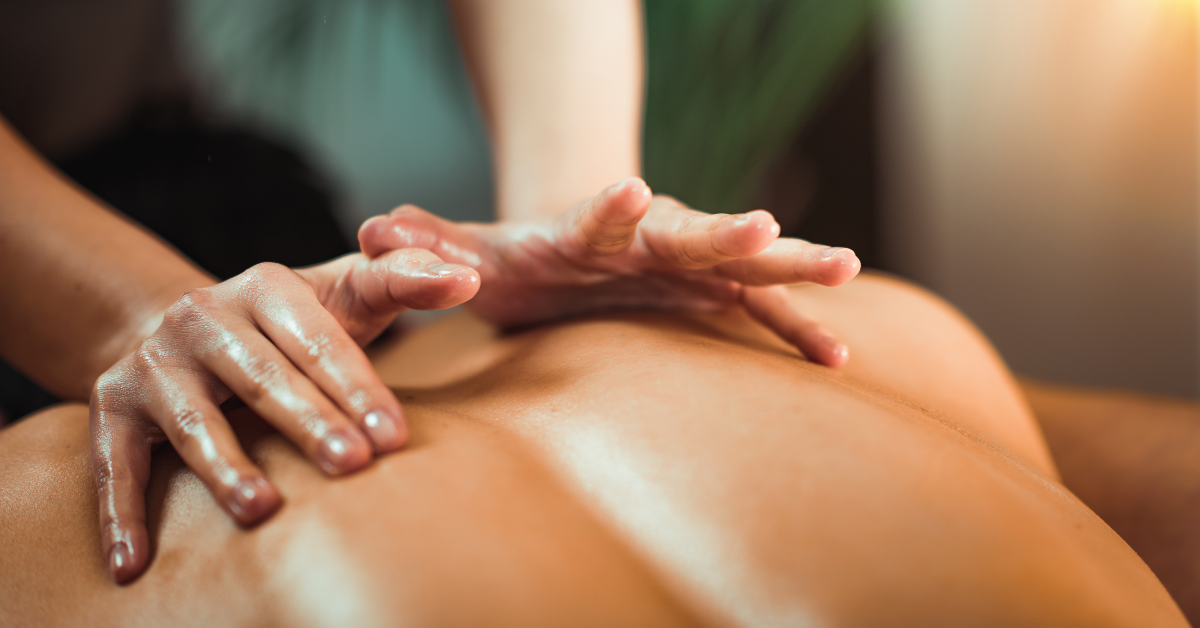 A person receiving a back massage